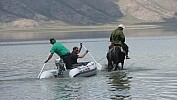 Our 30-PS-boat needs support by one vital horsepower. In Kyrgyzstan we want o find out about the monsoon variation in the past 10,000 years to do large-scale climate reconstructions. (Photo: Roman Witt)